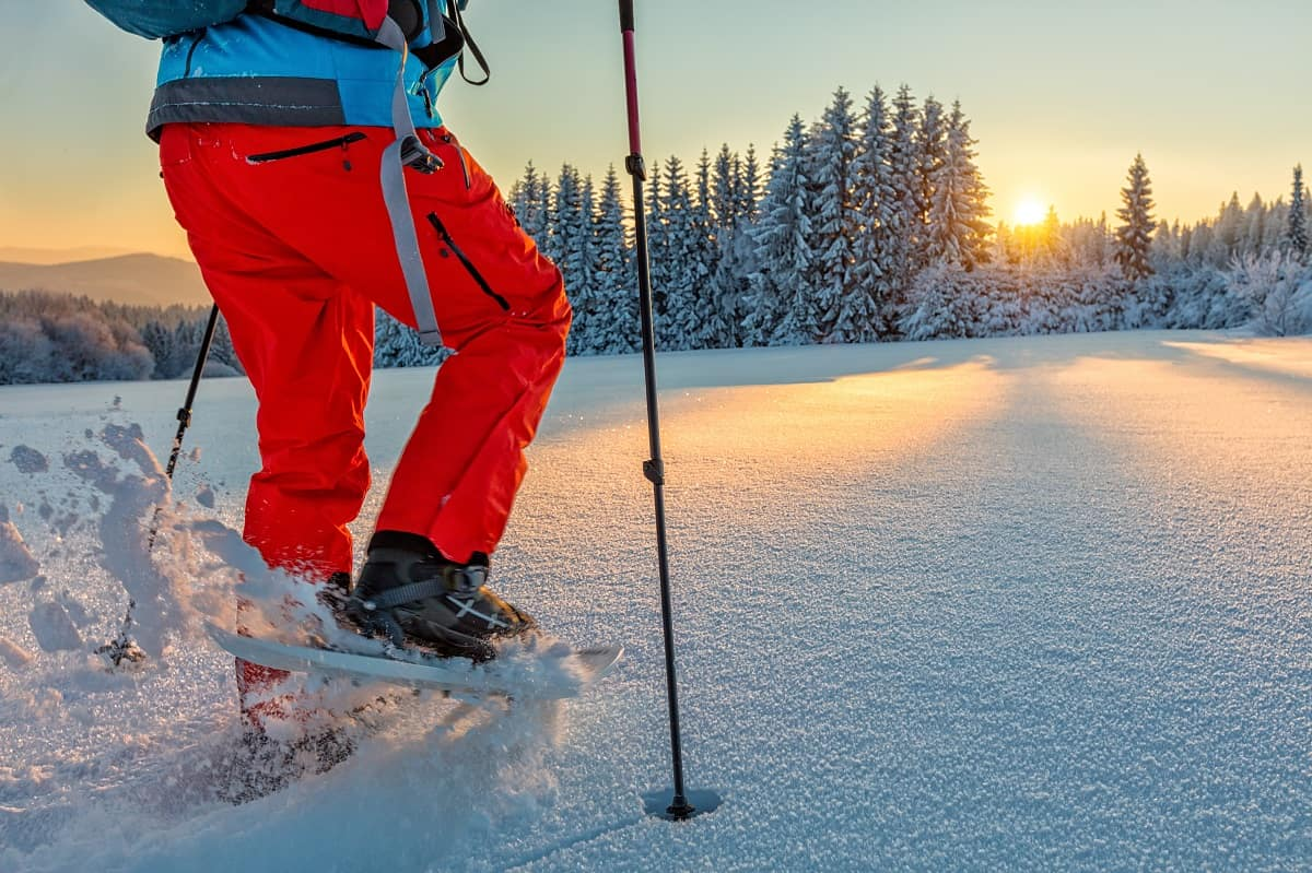 Detail of snowshoe walker in mountains with beautiful sunrise light. Outdoor winter activity and healthy lifestyle_shutterstock_554783914.jpg