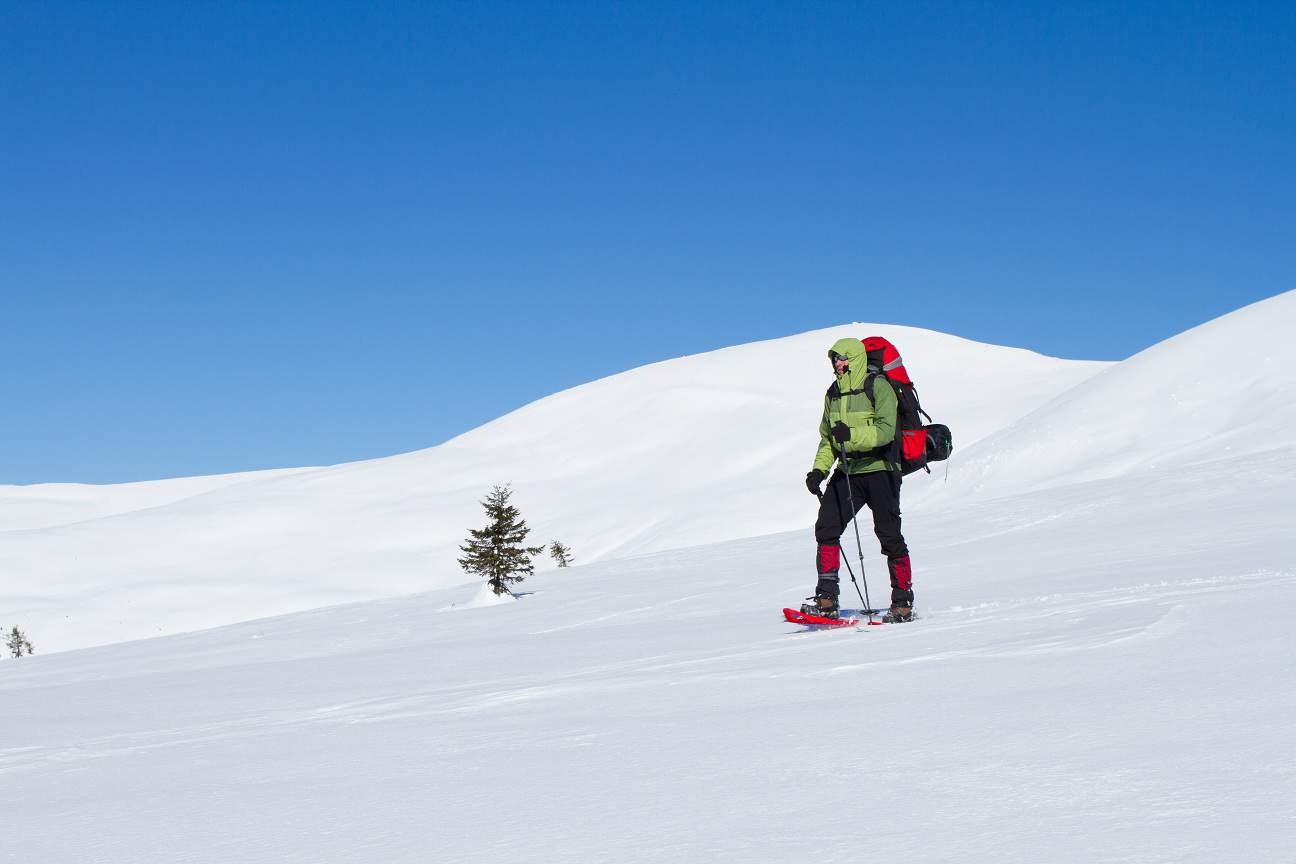 Winter hiking in the mountains on snowshoes with a backpack and tent._shutterstock_342006149.jpg